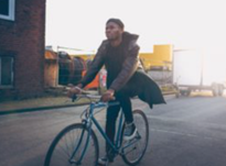 Photo of young man riding a bike